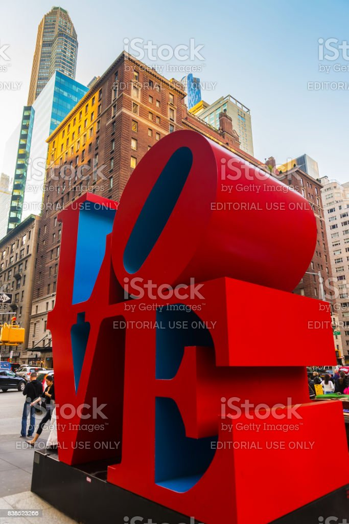 Love sculpture and tourists passing by in Midtown Manhattan NYC stock photo