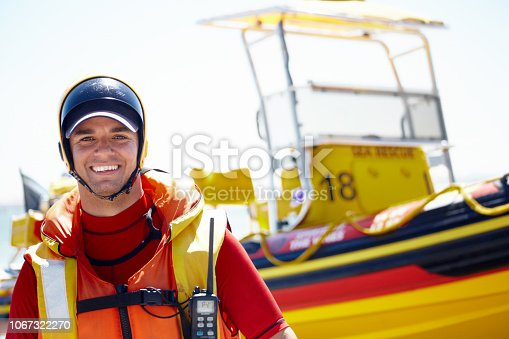 Cropped portrait of a handsome young male lifeguard preparing to go out to sea on a rescue mission