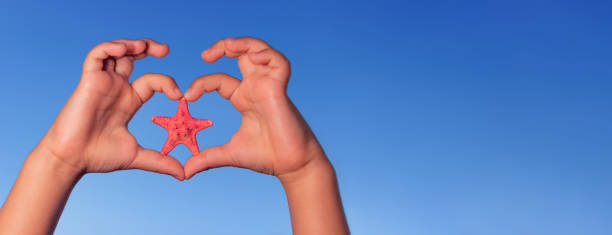 Love shape child hands with starfish summer background picture id840692002?b=1&k=6&m=840692002&s=612x612&w=0&h=ce8amgyp6dzkefanxif ho3rnfhlkg5cixmpflctcdy=