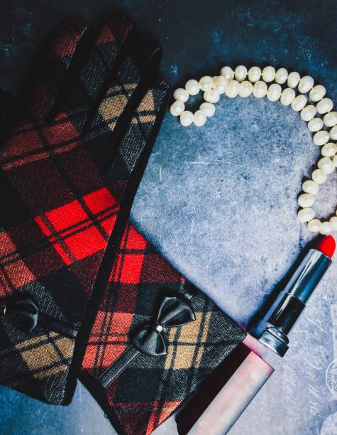 love sign, red lantern, pearls, and red lipstick make up a background , concept or story of love, valentines , romance, or murder mystery . - murder mystery stock photos and pictures