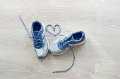 Love sign, Selective focus close up blue sport shoes