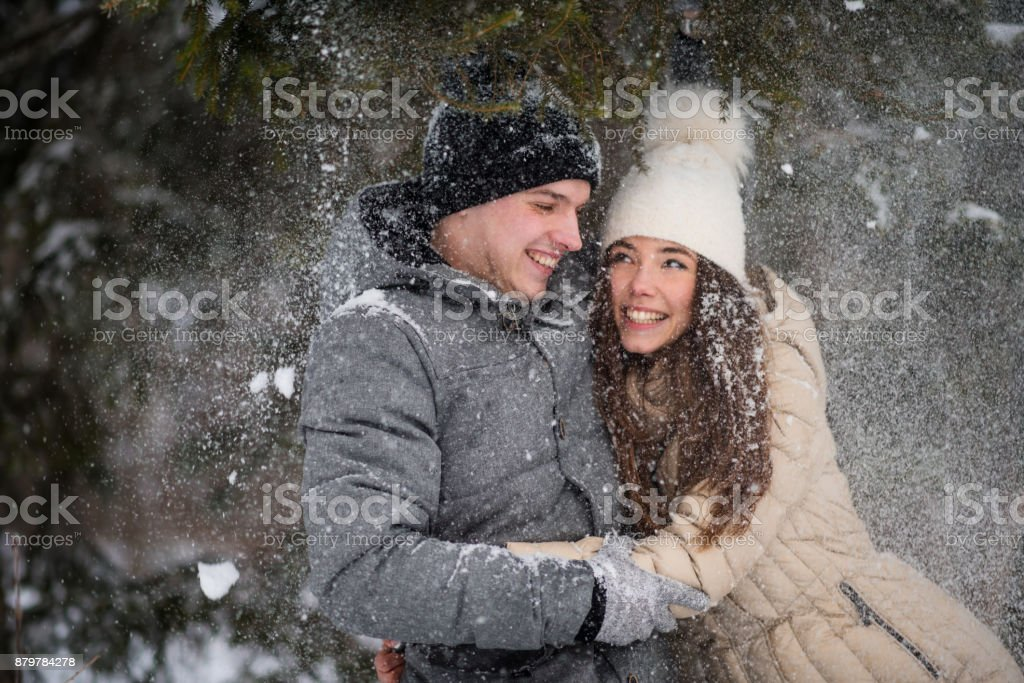 Love story of a young couple in winter stock photo