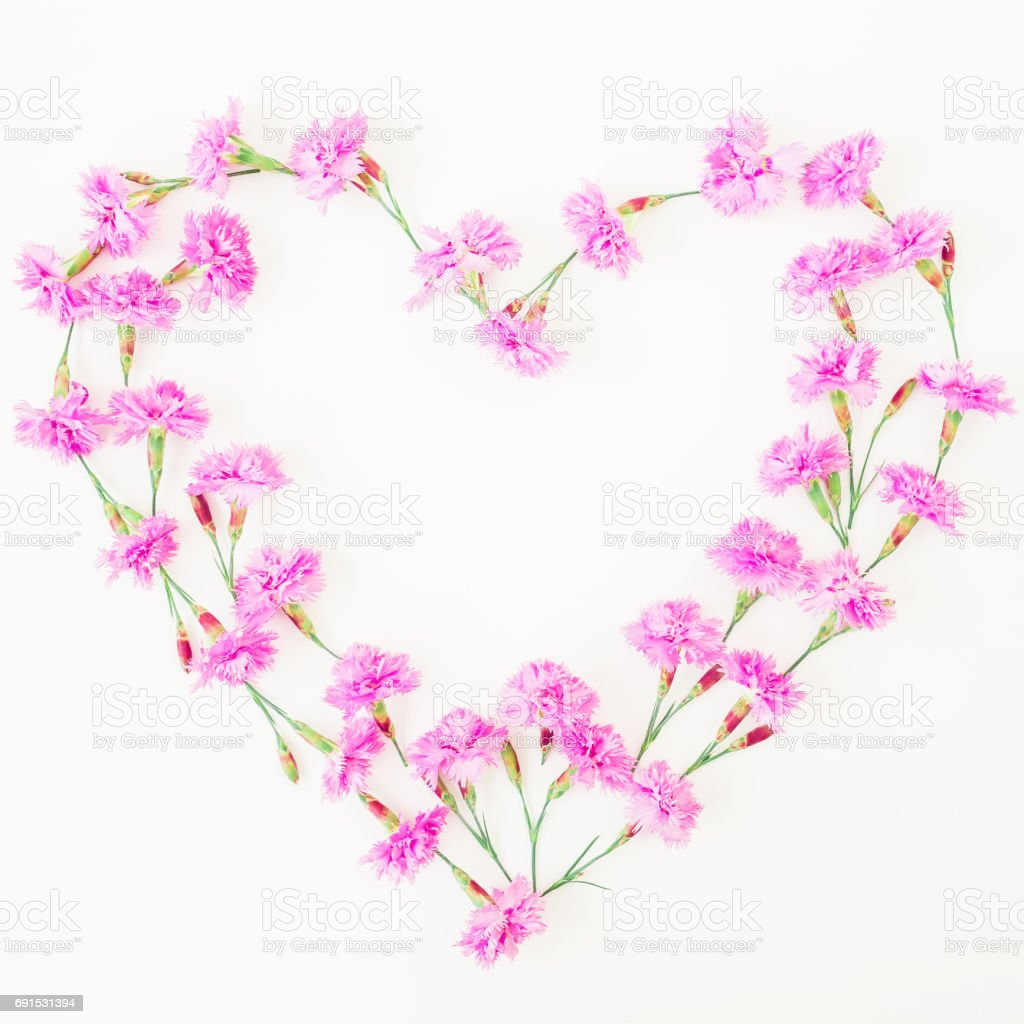 Love Symbol Made Of Pink Flowers On White Background Flat Lay Top