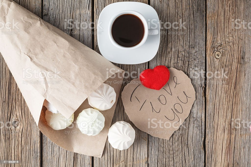 Love symol, red heart and sweets stock photo