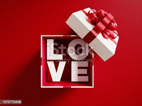 istock Love Text Coming Out Of A White Gift Box Tied With Red Ribbon 1070710448