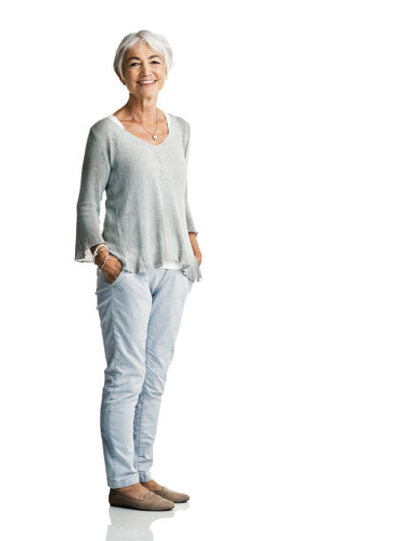 I love the peace and freedom that comes with retirement Studio portrait of a senior woman posing with her hands in her pockets against a white background hands in pockets stock pictures, royalty-free photos & images