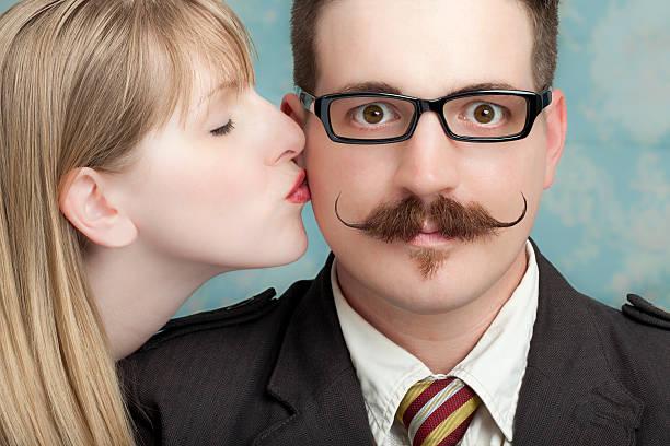 ama la tua baffo - brunette woman eyeglasses kiss man foto e immagini stock