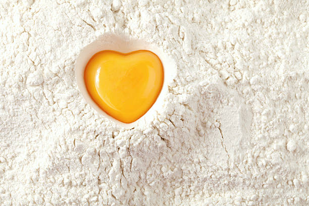 love to bake it!  egg  yolk on flour, full frame stock photo