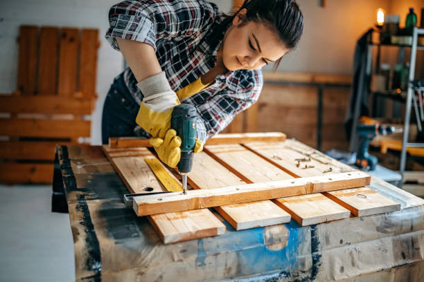 I love to do it myself Woman screwing screws in lath to make table diy stock pictures, royalty-free photos & images