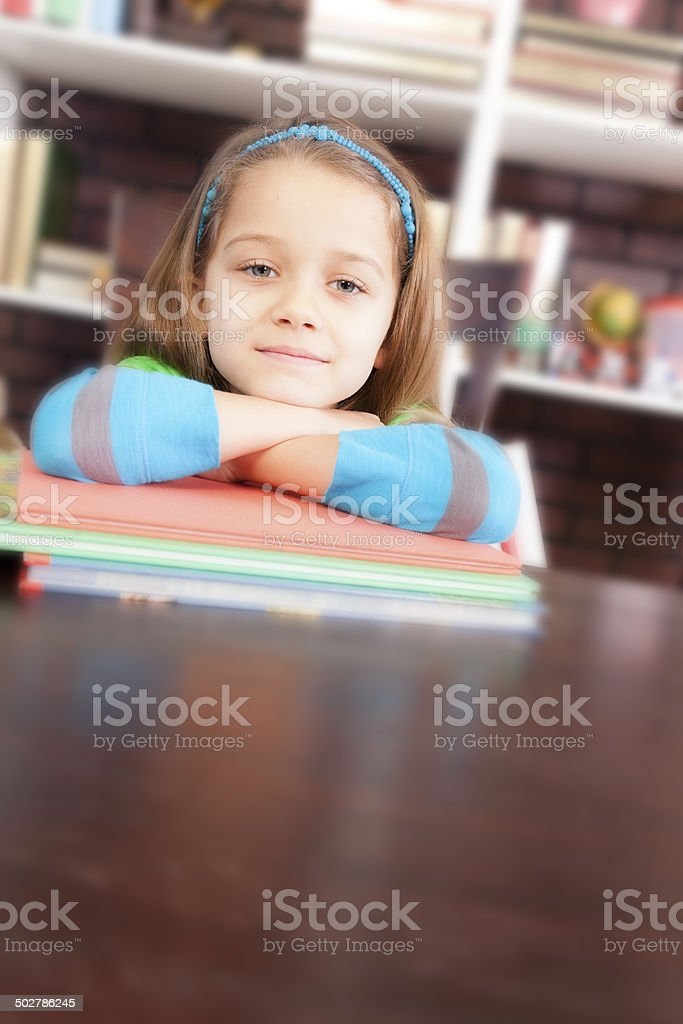 Love to read! Cute little girl at school desk. Book. royalty-free stock photo
