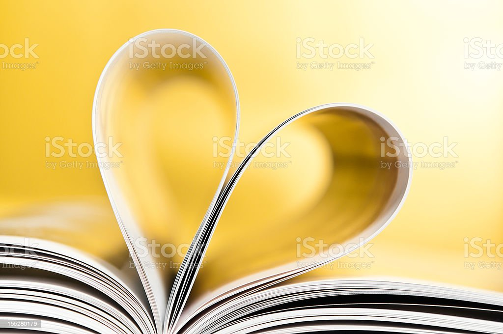 Love to reading books, pages folded into a heart shape royalty-free stock photo