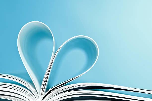 Love to reading books, pages folded into a heart shape stock photo