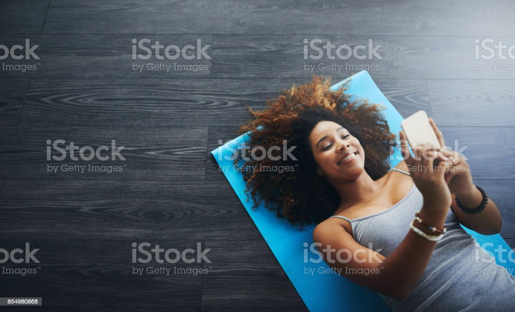 I love to take selfies after my yoga session stock photo