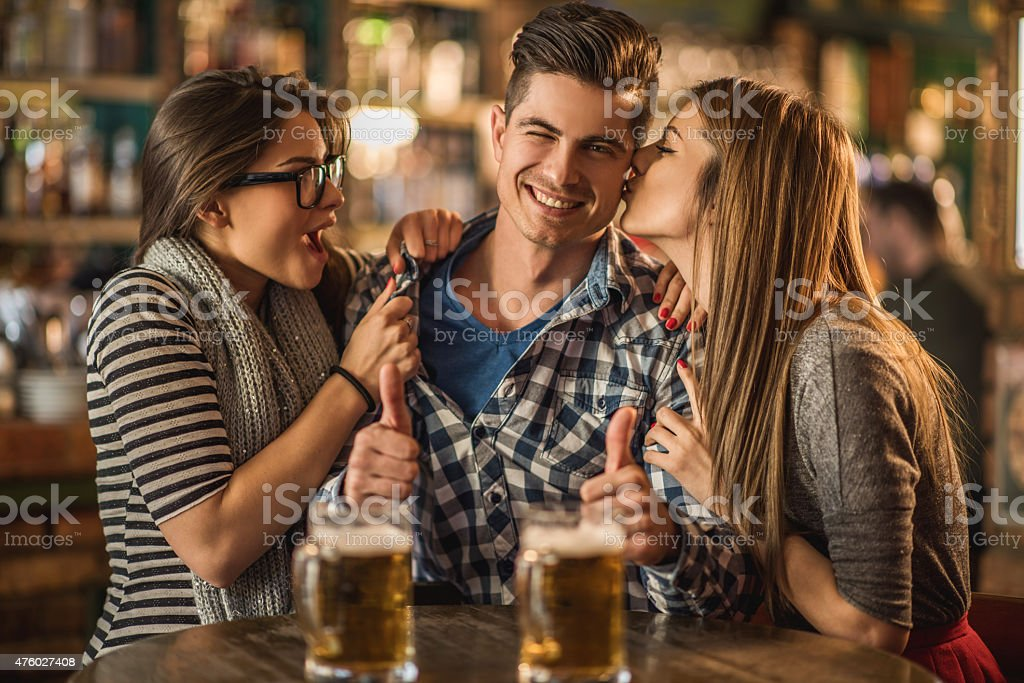 Love triangle in a bar. stock photo