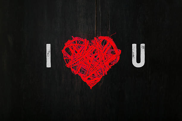 love valentines red heart shaped wreath on dark background - i love you stock photos and pictures