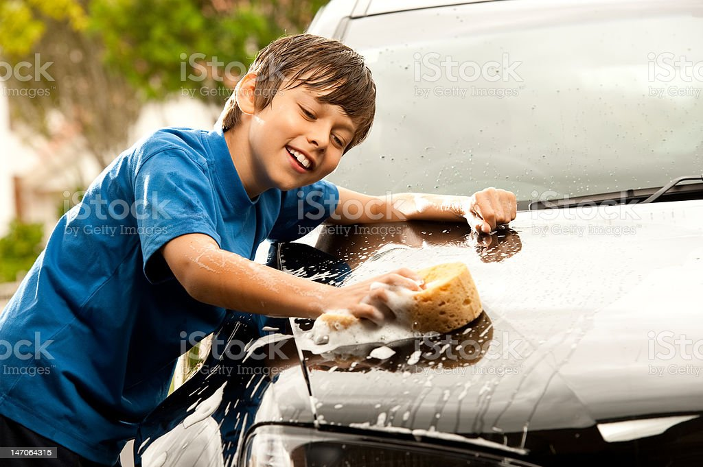 I love washing Dads car! stock photo