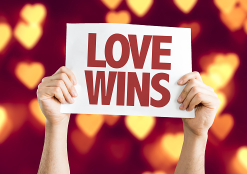 Love Wins card with bokeh background