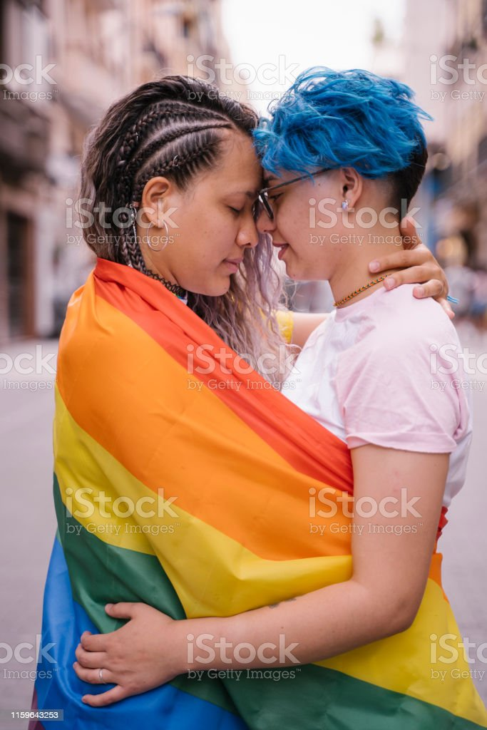 Candid intimate kiss. Homosexual relationship at young age.