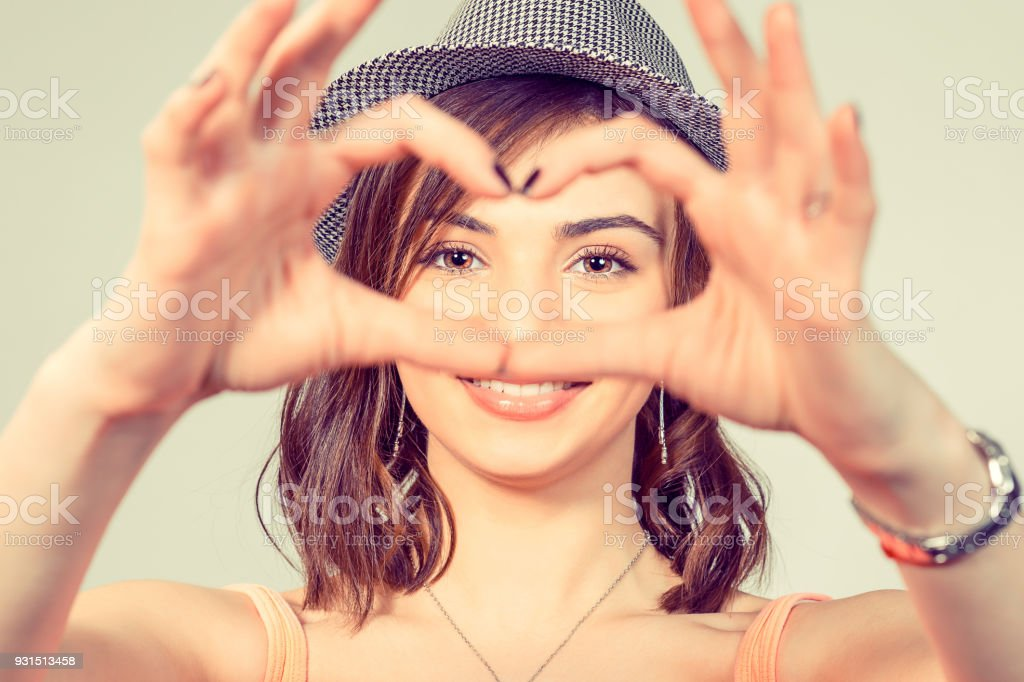 Love. Woman making heart sign, love symbol with hands stock photo