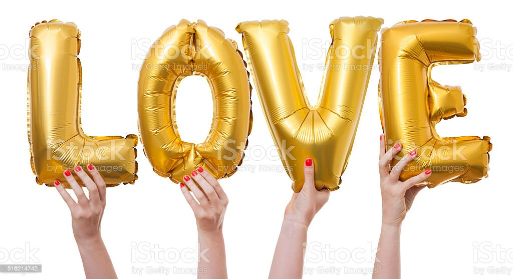 Love word made from gold balloons bildbanksfoto