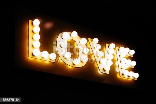 istock Love word made of glowing light bulbs. 636379164