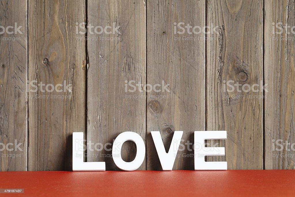 Love Wort auf rustikalen Holz-Wand – Foto