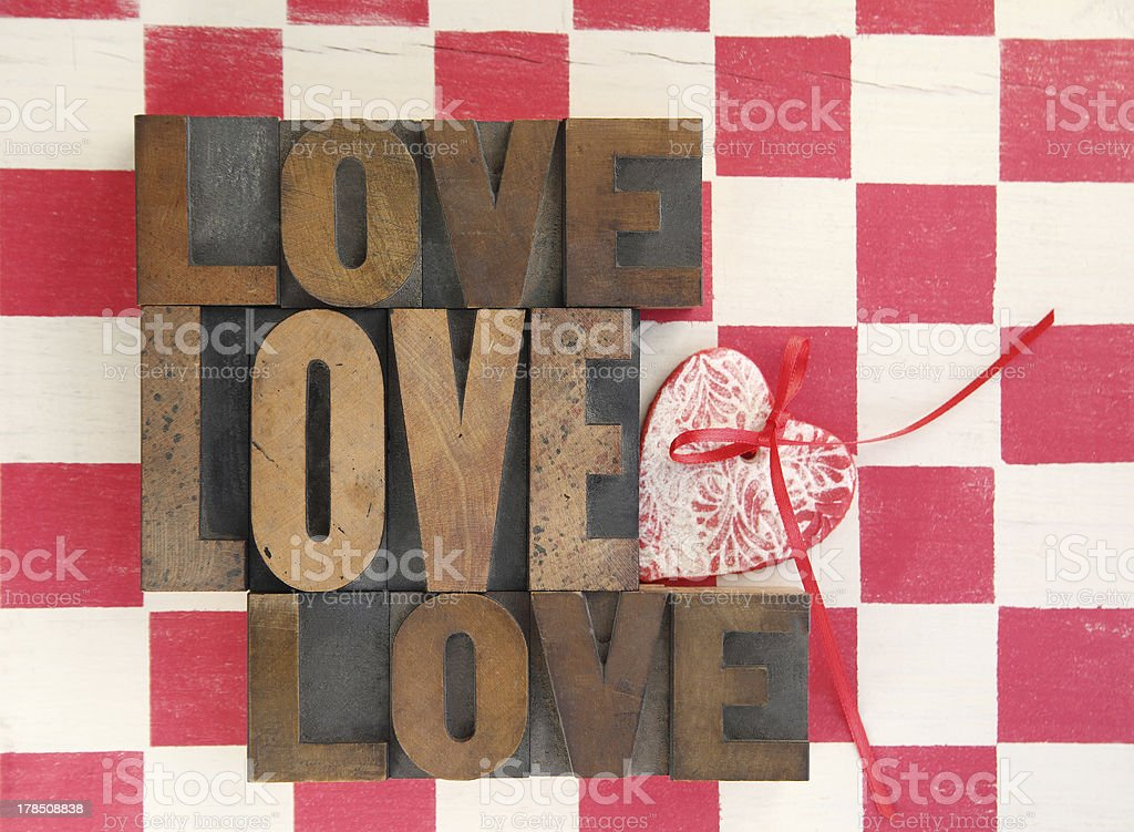 love words with heart on checked background royalty-free stock photo