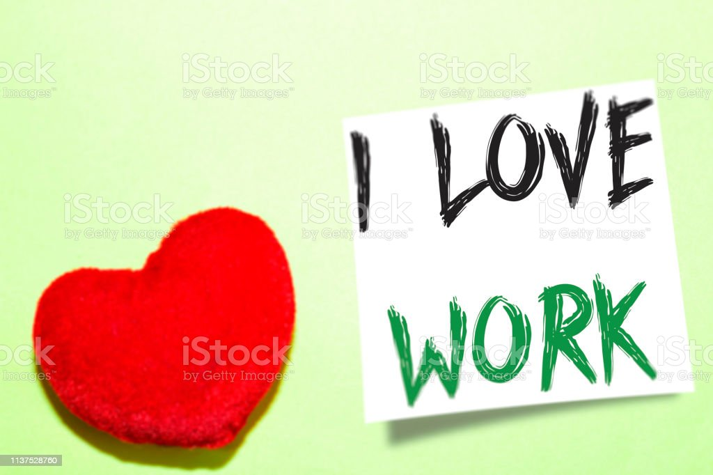 I love work handwritten on a white paper and heart shape in red
