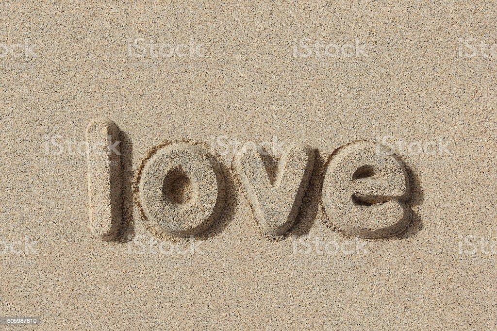 Love written in sand letters - foto de stock
