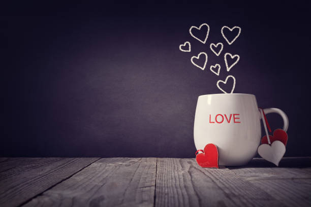 love written on a mug concept for valentines day or mothers day background with copy space - february stock photos and pictures