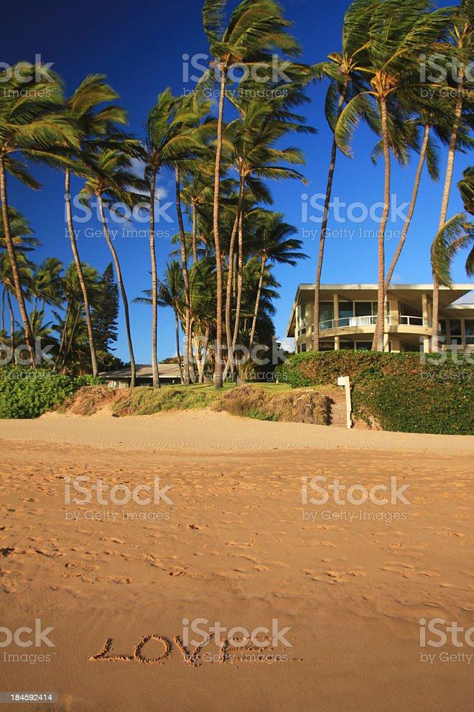 Love written on Maui Hawaii mansion house home beach sand royalty-free stock photo