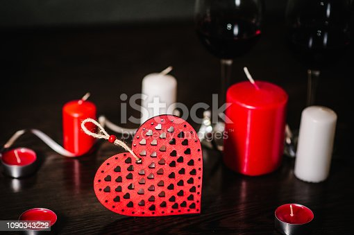 istock Love you concept with candle, wine, red hearts on brown wooden background. Place for text. concept Women's Day, eighth of March. Wedding, jubilee. St. Valentine's Day. 1090343222