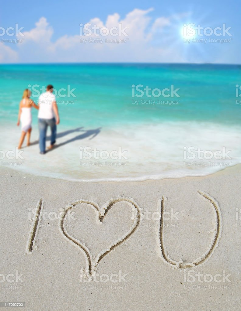 I Love You in Sand by Couple stock photo