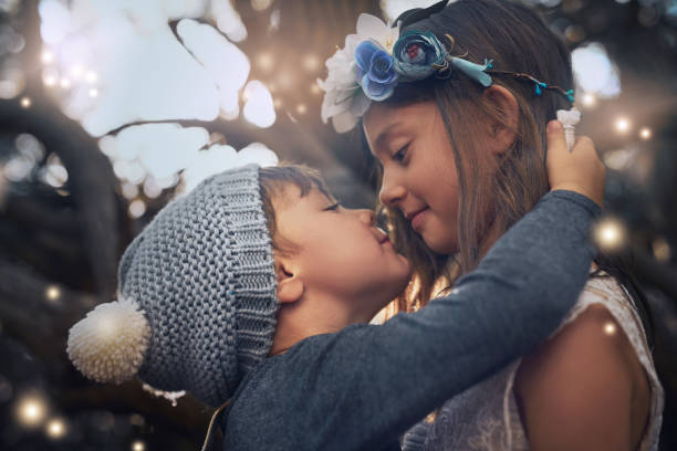 love you lots, big sis - little girls little boys kissing love stock photos and pictures