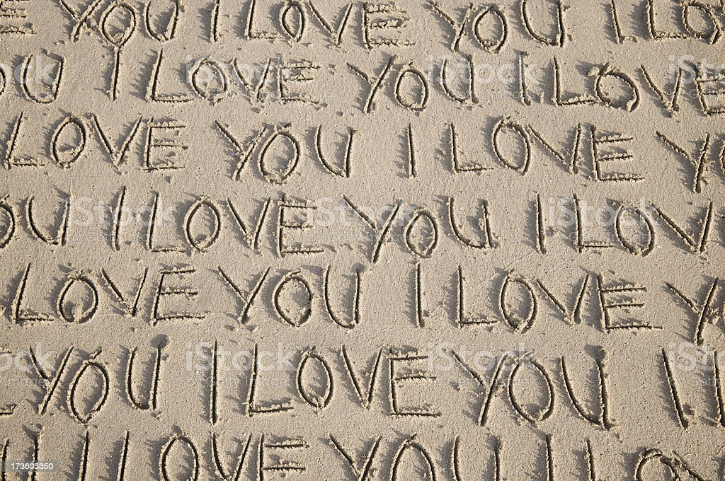 I Love You Message Handwritten Many Times in Sand stock photo