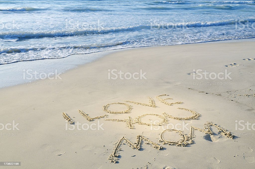 I Love You Mom Written in Sand on Mothers day stock photo