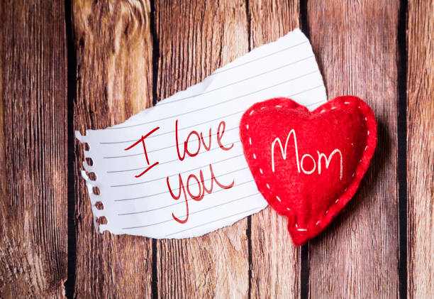 i love you mom written on notepad - happy mothers day type stock photos and pictures