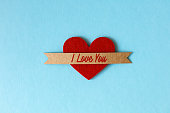 I love you on heart shape paper in blue color