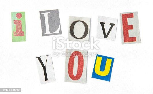 I love you. Paper cut letters. Newspaper magazine uppercase cutouts