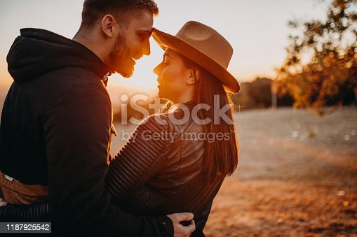 Couple smiling in sunset