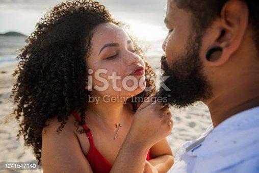 Young brazilian couple bonding at the beach