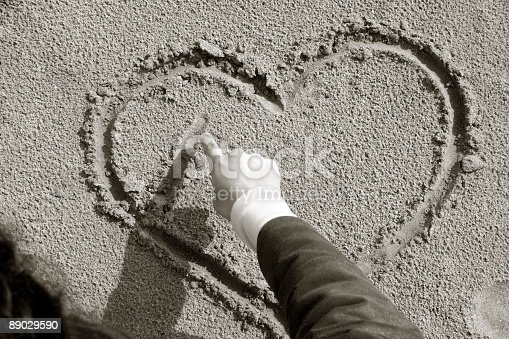 Drawing a hart in a sand