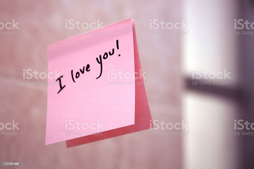 I love you pink post it note stuck to the wall stock photo