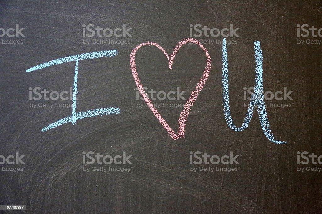 I love you symbol on chalkboard royalty-free stock photo