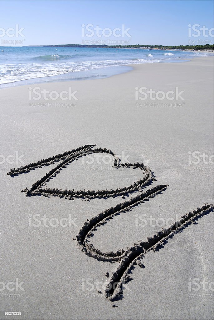 I love you written by hand on a sandy beach royalty-free stock photo
