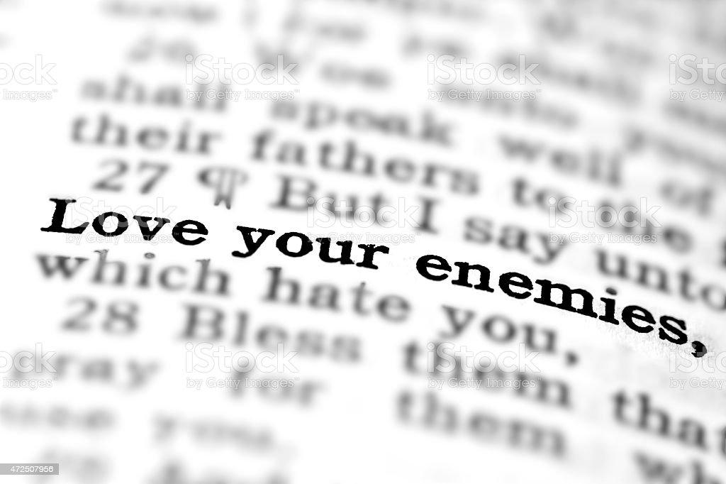 Love Your Enemies scripture in Bible stock photo