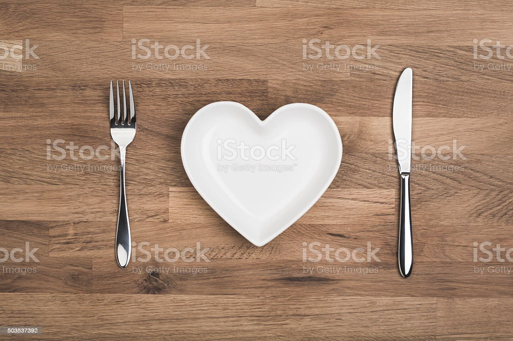 love your favourite food heart on white plate stock photo