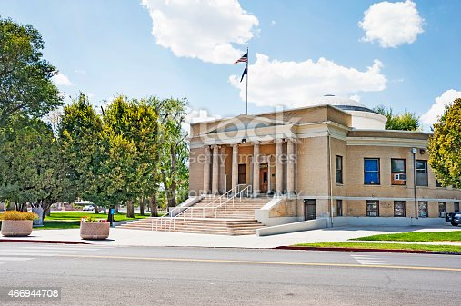 Lovelock, Nevada, USA - August 20, 2014: This courthouse building is located in the middle of Lovelock Nevada and stands out as a very attractive structure, outside the front is a memorial monument. The location here in town is convient for t he locals the building has scenes on their window coverings and under this cloudy day in August it was a great view.
