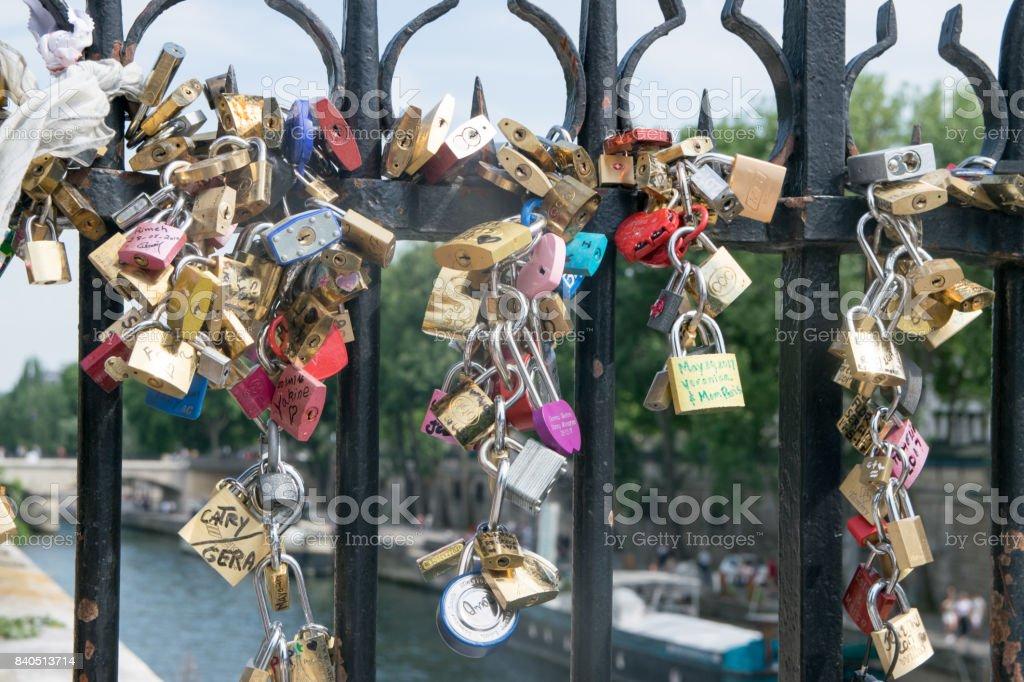 Lovelocks left at Seine bridges in Paris stock photo