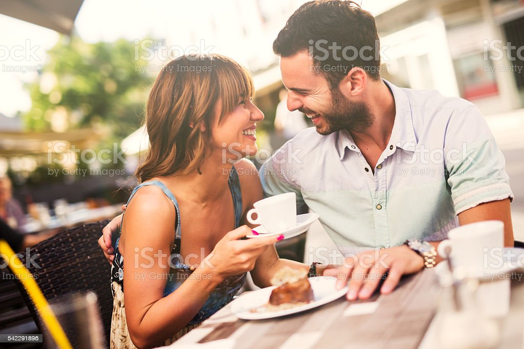 Lovely affectionate couple having fun together in a cafe. stock photo